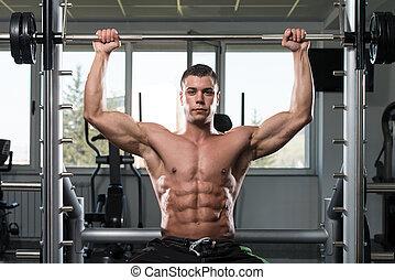 zware, schouders, gewicht, bodybuilder, mannelijke , oefening