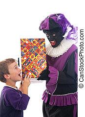 Zwarte Piet giving a child his present