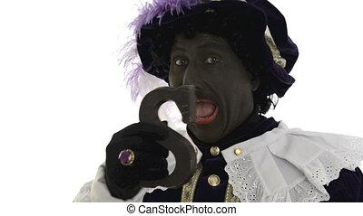 Zwarte Piet is eating chocolate - Zwarte Piet is eating a...