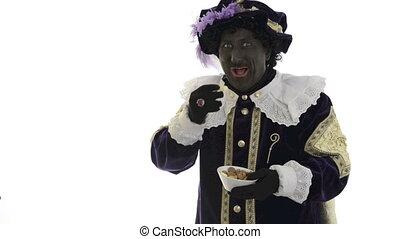 Zwarte Piet is eating gingernuts - Zwarte Piet is eating and...