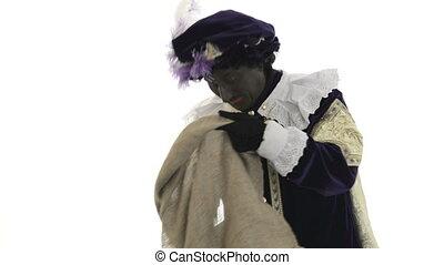 Zwarte Piet is throwing presents on a wite background