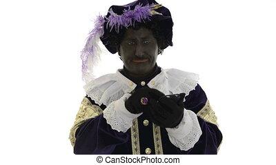Zwarte Piet using a mobile phone - Zwarte Piet is trying to...