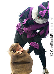 Zwarte Piet with a child in the bag, to take him to Spain...