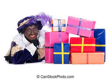 Zwarte Piet with a lot of presents - Zwarte Piet is a...
